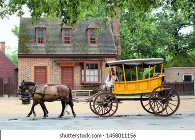 Williamsburg, PA / USA - August 8 2017: horse and yellow carriage on Duke of Gloucester street at Colonial Williamsburg