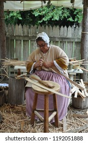 WILLIAMSBURG, VA - SEP 6: Basketmaker in Colonial Williamsburg in Virginia, as seen on Sep 6, 2015. Woven white oak baskets were as useful to Virginians as they were simple, beautiful, and strong.