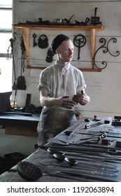 WILLIAMSBURG, VA - SEP 8: Blacksmith in Colonial Williamsburg in Virginia, as seen on Sep 8, 2015. The site re-creates the industrial complex owned and operated by James Anderson.