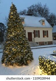 Williamsburg, VA, USA January 17, 2018  A rare snowfall in Williamsburg, Virginia highlights the Christmas decorations and lights at a historic home
