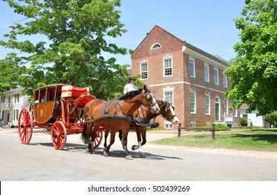 WILLIAMSBURG, VA, USA - MAY 7, 2012: Horse drawn carriage tours in British Colony in Williamsburg, Virginia, USA.