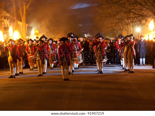 WILLIAMSBURG, VIRGINIA - DECEMBER 29: Fife and drum corps march in Illumination of the Taverns in Colonial Williamsburg on December 29, 2011. The Grand Illumination is on the first Sunday in December.