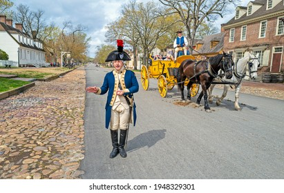 Williamsburg, Virginia, USA: 31st March 2021; Major General Marquis De Lafayette in downtown colonial Williamsburg talking as a carriage passes by.