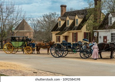 Williamsburg, Virginia , USA - April 1, 2018 : Horse drawn carriage tours in British Colony in Williamsburg, Virginia, USA.