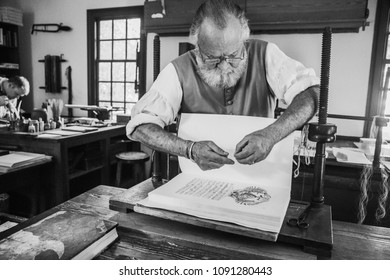 Williamsburg, Virginia USA, October 17, 2017, a gentleman works in the book bindery in Colonial Williamsburg.