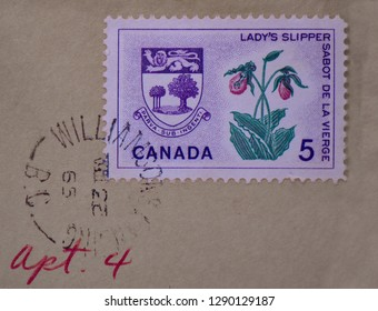 Williamsons Landing, British Columbia /Canada - 1965 : Post Office mark on a 5 cent Canadian 1965 stamp showing P.E.I's Province flower the Lady's Slipper.