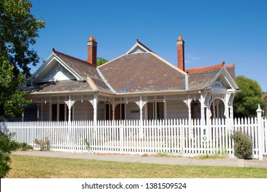 Williamstown, Australia: March 07, 2019: Traditionally built bungalow in the 20th century Australian style in Williamstown - with a porch, ornate verandah, and white picket fence.