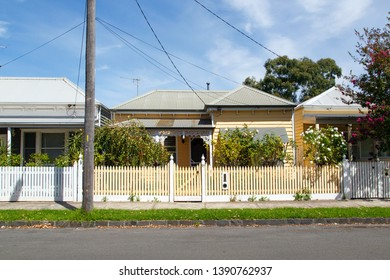 Williamstown, Australia: March 07, 2019: Traditionally built detached bungalow in the 20th century Australian style with a porch, ornate verandah, garden path, and painted picket fence.
