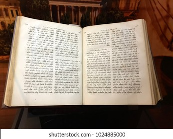 Williamstown, KY, USA - November 3, 2017:  Syriac New Testament from 1826 which mentions Paul's journeys in Syria in Syriac displayed in Noah's ark replica at the Ark Encounter Theme Park in Williamst