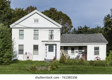 WILLIAMSTOWN, USA - SEP 21, 2017: typical wooden small farm house in victorian style in Bennington, Vermont, USA.  People decorate the house with stars and stripes and don't have a fence.