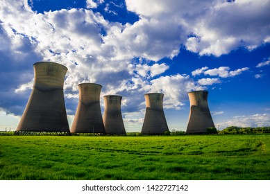 Willington, Derbyshire / UK - May 11 2019: Willington Power Station Cooling Towers under a cloudy blue-sky