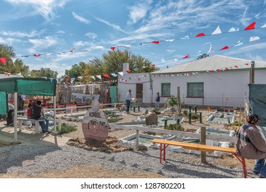 WILLISTON, SOUTH AFRICA, AUGUST 31, 2018: A putt-putt course at the yearly Winter Festival in Williston in the Northern Cape Province. People are visible