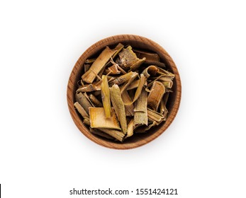 Willow bark in wooden Cup on white background.