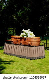 A willow casket - Environmentally Friendly and contemporary style - on a catafalque during an outdoor ceremony