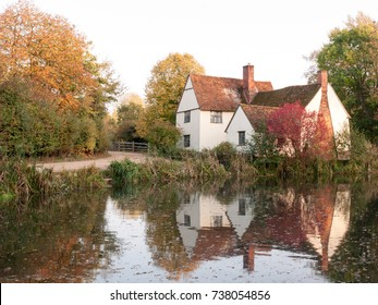 willy lotts cottage at flatford mill in suffolk in autumn reflections in lake; suffolk; england; uk