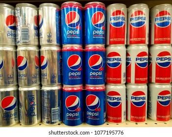 Wilmington, Delaware, U.S.A - April 25, 2018 - The cans of three Pepsi flavors - Diet Pepsi, Wild Cherry and Retro Design Pepsi on the shelves