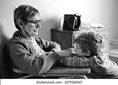 Wilmington, Delaware / USA - Dec. 29, 1982: A late-stage Alzheimer's sufferer, who could no longer speak, reconnecting with the young boy for whom she used to baby sit.