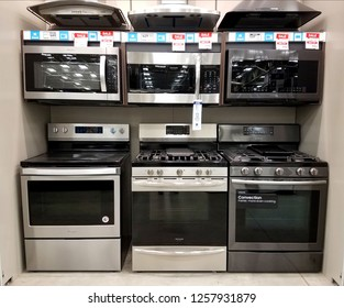 Wilmington, Delaware, U.S.A - December 13, 2018 - Selection of microwaves and electric kitchen stoves with oven at Lowe's