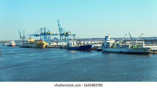Wilmington, Delaware, U.S.A - February 9, 2020 - The view of cranes and cargo ship on the dock along Delaware River