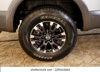 Wilmington, Delaware, U.S.A - October 5, 2018 - Alloy wheel of a Nissan truck on a General Grabber tire
