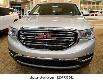 Wilmington, Delaware, U.S.A - October 5, 2018 - The front view of a brand new 2019 GMC Acadia SLE in white color