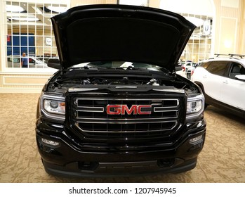 Wilmington, Delaware, U.S.A - October 5, 2018 - The trunk of the brand new 2019 GMC Sierra truck in black color