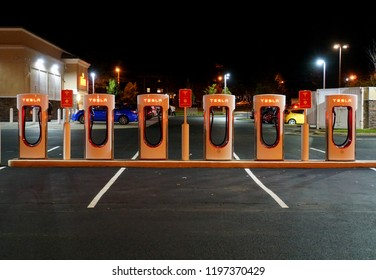 Wilmington, Delaware, U.S.A - October 6, 2018 - Tesla supercharging stations illuminated at night