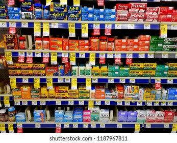 Wilmington, Delaware, U.S.A - September 23, 2018 - Variety of cold, cough and flu medicine on the shelves at Walgreens