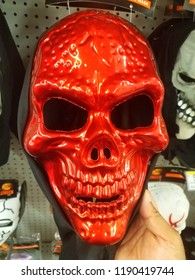 Wilmington, Delaware, U.S.A - September 27, 2018 - Shiny red skull face mask for sale at Walgreens