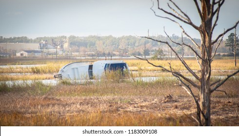 Wilmington, NC / USA - 9/18/2018: A yacht is wrecked along the banks of the Cape Fear River near downtown Wilmington, NC, after Hurricane Florence.