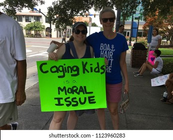 Wilmington, NC, USA / June 30, 2018. NAACP Rally to Reunite Families. Wilmington North Carolina citizens and visitors rally and show support. signs and speakers
