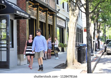 Wilmington, NC/USA- 06/24/2018:  A couple strolls along the streets of historic downtown Wilmington.