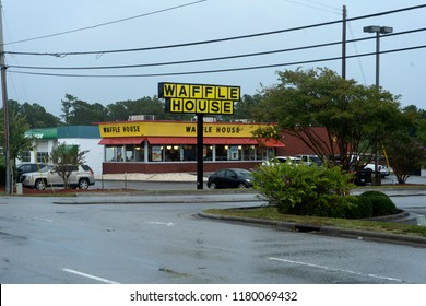 Wilmington, North Carolina / United States - September 13, 2018 - A Waffle House  open during  emergency evacuation just before Hurricane Florence.  FEMA uses Waffle House as a severity gauge.