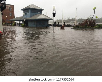 Wilmington North Carolina - USA / September 14, 2018. Downtown Wilmington begins to flood from storm surges. Visitor center on the foot of Market and Water St covered half way with flood waters