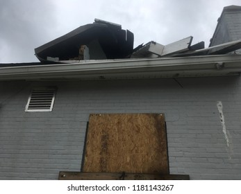Wilmington North Carolina - USA / September 16, 2018. The continued aftermath of Hurricane Florence on downtown. Roof pushed up