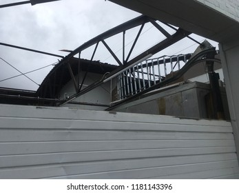 Wilmington North Carolina - USA / September 16, 2018. The continued aftermath of Hurricane Florence on downtown. New brewery being built and tooled out sees their entire roof ripped off