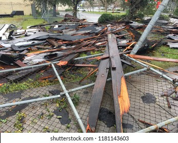 Wilmington North Carolina - USA / September 16, 2018. The continued aftermath of Hurricane Florence on downtown. Wooden debris from rooftop half a block away