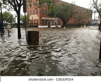 Wilmington, North Carolina - USA / September 14 & 15, 2018. Cape Fear River flooding due to Hurricane Florence and storm surge aftermath. South Water St building sees flooding at its doorstep