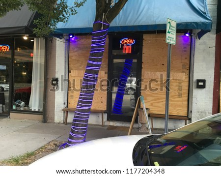 Wilmington North Carolina - USA / September 11, 2018. Downtown businesses boarding up for Hurricane Florence. Local businesses boarding up for Hurricane Florence