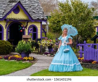 Wilmington, North Carolina/USA-04/05/2019: The Cape Fear Garden Club 66th Azalea Garden Tour features the Azalea Belles and professional artist who paint in the gardens. Wilmington NC Spring event