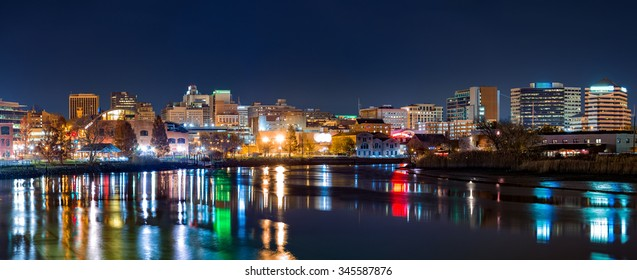 Wilmington skyline panorama reflected in Christiana River. Wilmington, the largest city in the state of Delaware, is built on the site of Fort Christina, the first Swedish settlement in North America