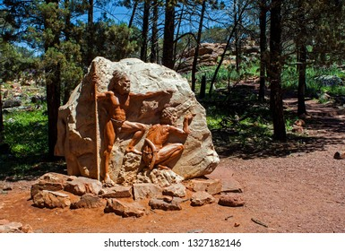 WILPENA POUND, SOUTH AUSTRALIA, AUSTRALIA - 19 OCTOBER 2010: A rock carving, featuring an aboriginal theme, beside a Wilpena Pound walking track in the heart of the Flinders Ranges National Park.