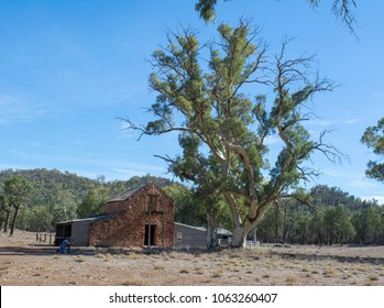 Wilpena Pound, South Australia, Australia - March 15, 2018: Male photographer in front of the store at the Old Wilpena Station, a working station until 1985 within the Ikara-Flinders Ranges.
