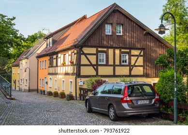 Wilsdruff, Germany - May 30, 2016: View of the Half-timbered residential house and the car in front of it in a small town Wilsdruff, a suburb of Dresden, Germany. Dresden is 14 km from the town.