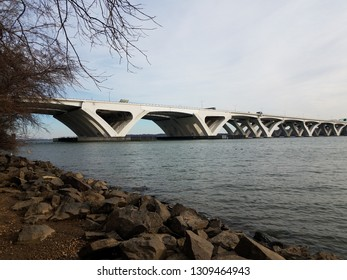 Wilson bridge and Potomac river with rocks and shore