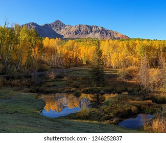 Wilson Mesa Colorado. Gold aspens foreground show how sublime Wilson peak is. This was taken late September near Telluride, Colorado.