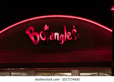 WILSON, NC - JANUARY 25, 2018: A Bojangle's restaurant sign is illuminated at night. Bojangles' Inc. is a Southeastern regional chain of fast food restaurants, specializing in Cajun fried chicken.
