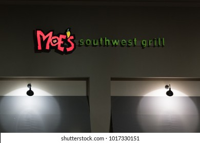 WILSON, NC - JANUARY 25, 2018: A Moe's Southwest Grill sign is illuminated at night. Moe's is a fast casual dining Mexican restaurant with over 680 locations.