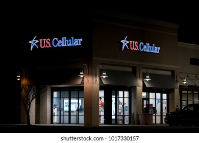 WILSON, NC - JANUARY 25, 2018: A US Cellular location at night. U.S. Cellular is a regional carrier which owns and operates the fifth-largest wireless telecommunications network in the United States.