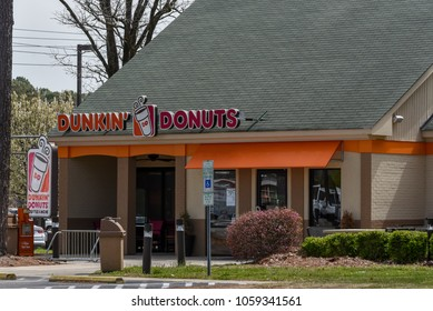 WILSON, NC - March 28, 2018: The entrance and sign to a Dunkin Donuts restaurant in Wilson, NC.